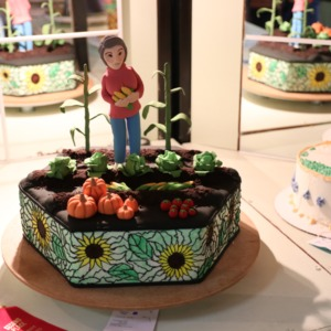 Award-winning cake decorated as woman in vegetable patch at North Carolina State Fair, 2018