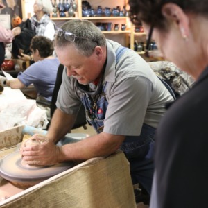 Potter at potter's wheel at North Carolina State Fair, 2018
