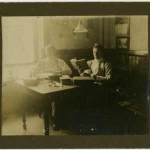 Joseph Alfred Miller and other student in dorm room