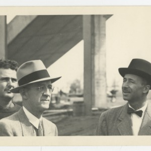 Superintendent E. F. Fulton, William Deitrick, and Pietro Belluschi on the construction site of Dorton Arena, 1951-1952