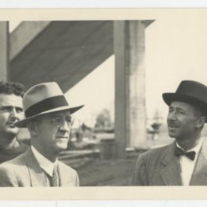 Superintendent E. F. Fulton, William Deitrick, and Pietro Belluschi on the construction site of Dorton Arena, 1951-1952