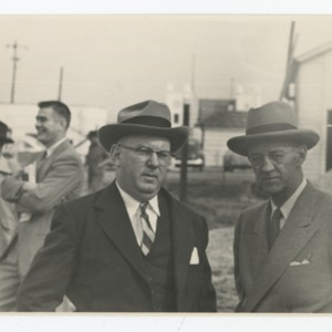 Contractor William Muirhead and William Henley Deitrick on the construction site of Dorton Arena, 1951-1952