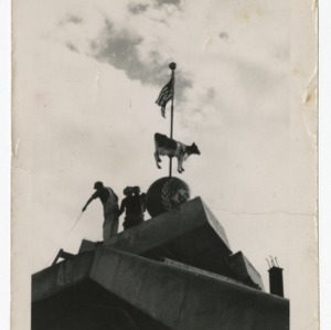 "Dorton Arena construction workmen installing ""Cow Palace"" flagpole, 1951-1952"