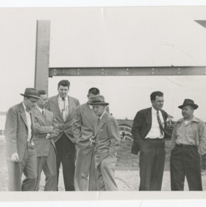 Dorton Arena's architects, engineers, and others on its construction site, 1951-1952