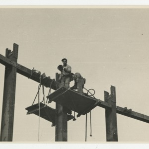 Dorton Arena's workmen atop riveted scaffolding