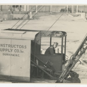 Workman operating construction machinery on Dorton Arena's construction site, 1951-1952