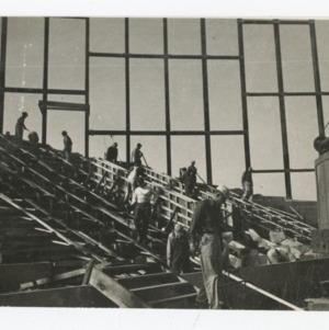 Workmen in interior of Dorton Arena on Dorton Arena's construction site, 1951-1952