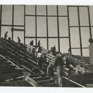 Workmen in interior of Dorton Arena on Dorton Arena's construction site, 1951-1952