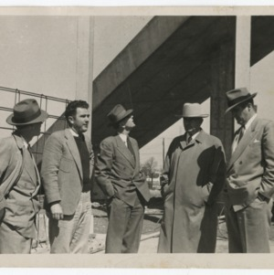 Superintendent E. F. Fulton, Governor W. Kerr Scott, William Deitrick, and others on Dorton Arena's construction site