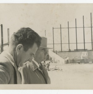 Superintendent E. F. Fulton and Governor W. Kerr Scott on Dorton Arena's construction site
