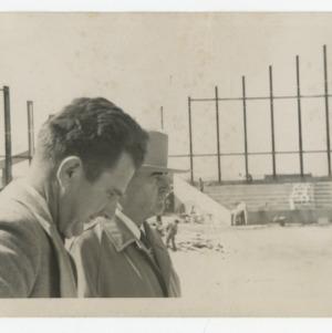 Superintendent E. F. Fulton and Governor W. Kerr Scott on Dorton Arena's construction site