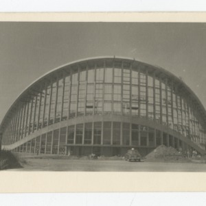 Exterior view of a finished section of concrete of Dorton Arena during its construction, 1951-1952