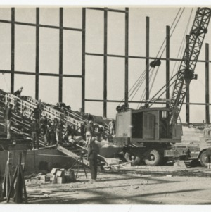 Crane being operated on construction site of Dorton Arena, 1951-1952