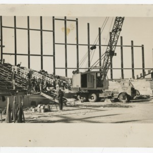 Crane being operated on interior of Dorton Arena during its construction, 1951-1952