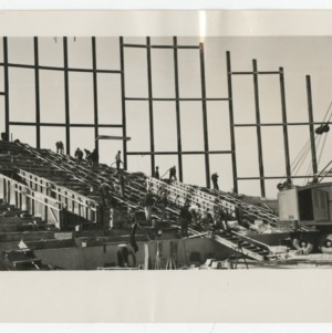 Workmen on the steps of Dorton Arena during its construction, 1951-1952