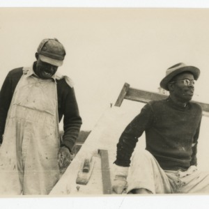 Two workmen finishing the concrete for Dorton Arena, 1951-1952