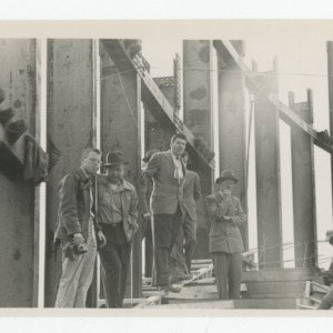 Group of workmen on construction site of Dorton Arena