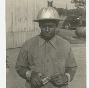 Workman on the construction site of Dorton Arena
