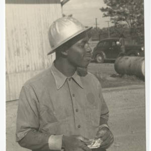 Workman on the construction site of Dorton Arena