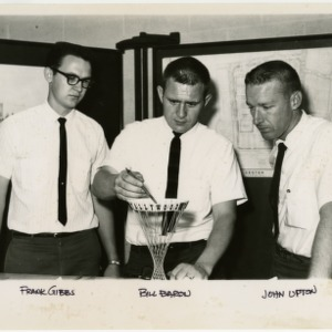 Frank Gibbs, Bill Baron and John Upton with Tallywood Sign