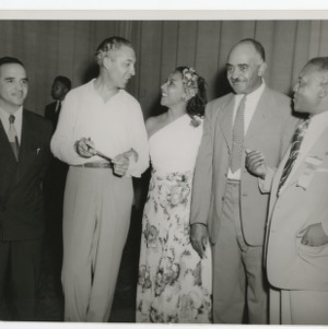 A Photograph of S.B. Simmons with an Unidentified Group
