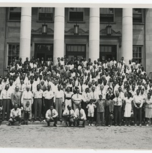 A Photograph of an Unidentified Group with S. B. Simmons Kneeling