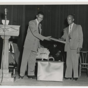 A Photograph of Unidentified Men on Stage
