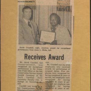 Receives Award