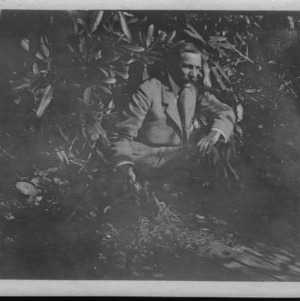 Dr. Carl Schenck posing in the rhododendrons