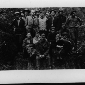 Group portrait with Dr. Carl Schenck in forest