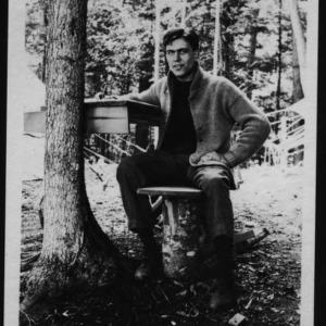 Ben Alexander at desk in woods