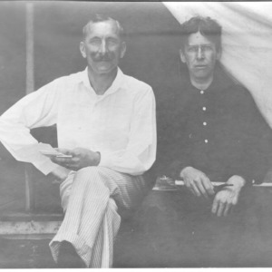 Dr. Carl Schenck and other in front of tent