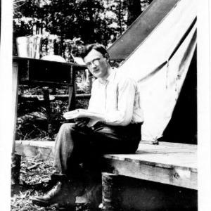 Dr. Homer D. House outside tent