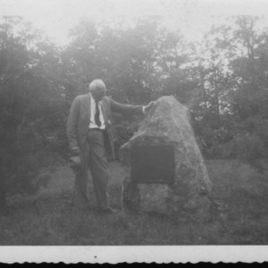 Dr. Carl Schenck beside his own monument