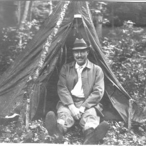 Dr. Carl Schenck outside tent