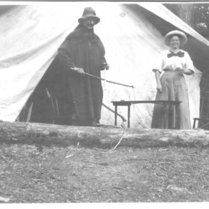 Dr. Carl Schenck and Adele Schenck in front of tent