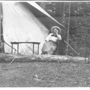 Adele Schenck in front of tent