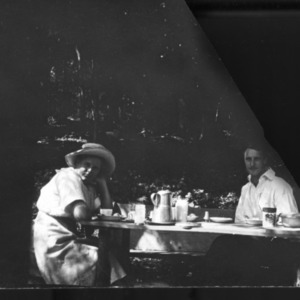 Adele Schenck and other seated at table