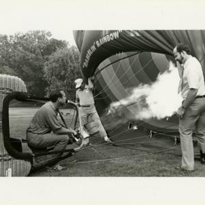 Men starting hot air balloon