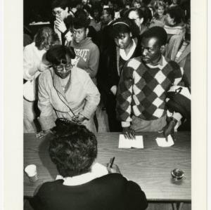 Maya Angelou signing autographs