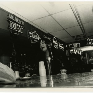 Bartender talks to customers