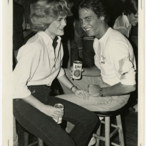 Man and woman chat over Miller Lite