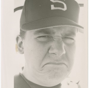 Close-up of man in NC State baseball cap