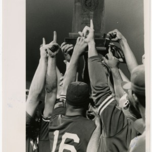 NC State team holds up trophy celebrating their 1992 ACC Championship