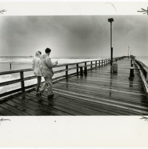 Couple walks the boardwalk