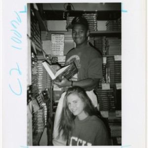 Students browse bookstore shelf