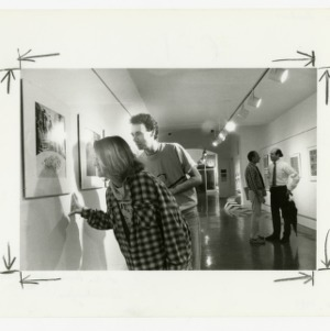 Architecture students check out artwork at the Brooks Hall art exhibit