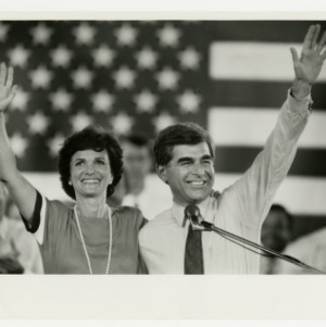 Presidential candidate Mike Dukakis and his wife, Kitty, wave to a crowd at Dorton Area after a campaign stop
