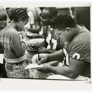 NC State football players sign autographs for kids at Fred Olds Elementary School