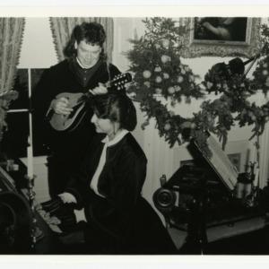 Man and woman playing music at Christmas